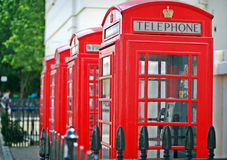 Phone box in England. A series of phone boxes in the heart of London. A classic symbol of British culture Stock Image