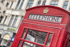 Phone box. Famous London phone booth along the street Stock Photo