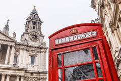Phone box and Saint Pauls cathedral in winter day royalty free stock photography