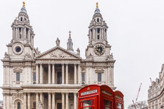 Phone box and Saint Pauls cathedral in winter day Stock Image