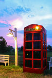 Phone box at side of field on twilight time Stock Photos