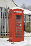 Phone Box Snow. Old red telephone box in the United kingdom covered in snow Stock Photo