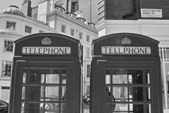 Phone Boxes. Two Phone boxes side by side in Great Milton Street, UK stock photos