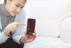 Phone that is broken In the hands of women. stock images