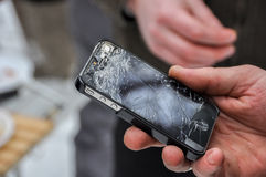 Phone with a broken screen. In a hand stock photography