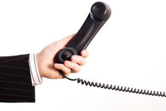 Phone in a business hand. Telephone in a business hand Royalty Free Stock Images