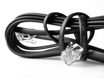 Phone cable 2. Black phone cable with connectors Royalty Free Stock Images
