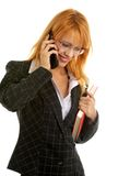 Phone call. Businesswoman with book making a phone call Stock Photo