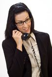 Phone Call. Woman holding an old school phone smiling royalty free stock photography