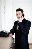 Phone call. Businessman taking phone call in office Royalty Free Stock Images