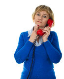 Phone call. Mature 50 years old blonde woman during phone call - isolated on white background Stock Photos