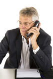 Phone-call. Phonecall by a senior at the office Stock Images