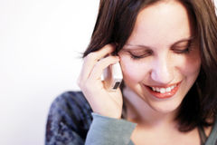 Phone call. A beautiful young woman with cellphone laughing Stock Image