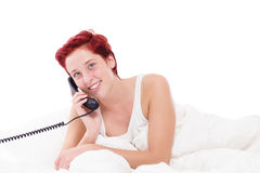 Phone call in bed Royalty Free Stock Images