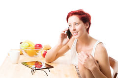 Phone call at breakfast Royalty Free Stock Image