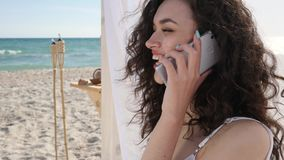 Phone call for girl on beach, summer vacation to tropical islands, female talking at mobile on embankment, stock video