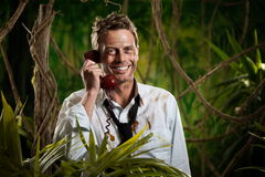 Phone call in jungle wilderness Royalty Free Stock Photos