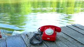 Phone Call. Old telephone ringing by the lakeside stock video
