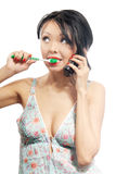Phone call and toothbrushing Royalty Free Stock Photos