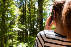 Phone call in the woods Stock Photos