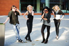Young people calling on the phones. Group of young people calling on the mobile phones Royalty Free Stock Photos