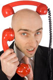 Phone calls. Businessman on phone juggling two calls at the same time stock photography