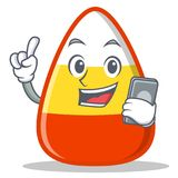 With phone candy corn character cartoon Royalty Free Stock Image