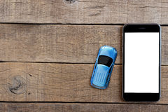 phone and car model toy on wood table top Stock Images