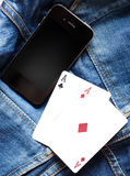 Phone and cards Royalty Free Stock Photo