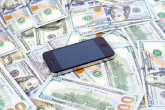 Phone and cash. Mobile phone and cash money dollars currency abundance connectivity Royalty Free Stock Image