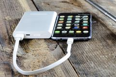 Phone and charge power bank Stock Image