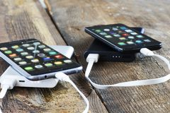 Phone and charge power bank Royalty Free Stock Images