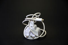 Phone charger. 3 pin mobile phone charger, travel light, white Stock Photo