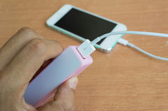 Phone charger with power bank in hand Royalty Free Stock Image