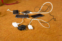Phone Chargers on the floor Royalty Free Stock Image