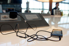 Phone charging on a airport . Phone charging on a table at charging station in the lobby. Free charging on the airport terminal Royalty Free Stock Photography