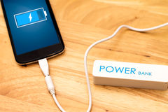 Phone charging with energy bank Royalty Free Stock Photos