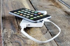 Phone and charge power bank Stock Photos