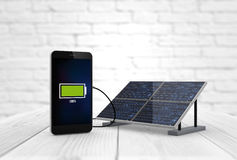 Phone charging solar pannel. Digital generated smart phone charging with solar pannel. Screen graphics are made up Stock Photos