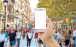 Phone in the city Stock Photography
