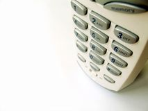 Phone close up - 2. Close up top view of a cordless phone on white background, shallow DOF, with copy space Stock Image