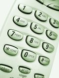 Phone close up - 5. Close up view of a cordless phone, showing numerical keypad, green hue Royalty Free Stock Photo