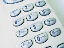 Phone close up. Close up view of a cordless phone, showing numerical keypad on its original blue-on-white color royalty free stock photo