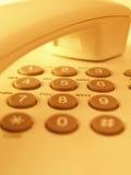 Phone closeup. Closeup of a yellow toned phone Stock Photography