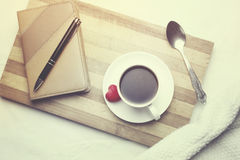 Phone and coffee. Phone and cup of coffee on the bed Royalty Free Stock Photos