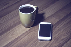 Phone and coffee. Coffee cup and cell phone Stock Photo