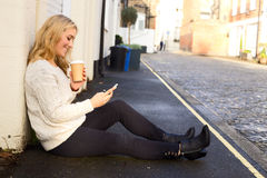 Phone and coffee Royalty Free Stock Photos