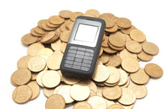 Phone on coins Royalty Free Stock Image