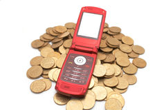 Phone on coins Stock Images