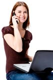 On Phone and Computer Stock Image
